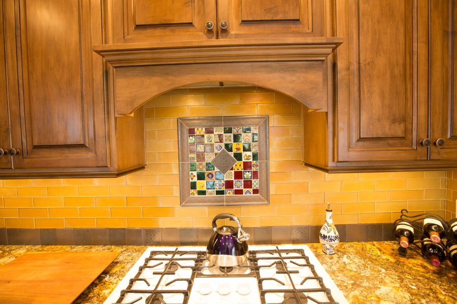 granite-slab-kitchen-tile-backsplash-custom-cabinetry